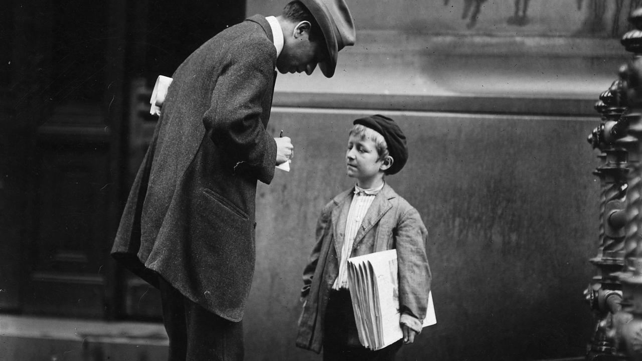 Michael McNelis, 8 years old, a newsboy. This boy has just recovered from his second attack of pneumonia. Was found selling papers in a big rain storm today. Philadelphia, Pa.